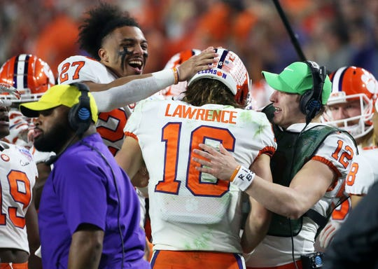 Dec 28, 2019; Glendale, AZ, USA;  Clemson Tigers quarterback Trevor Lawrence (16) celebrates after running for a 67-yard touchdown against Ohio State in the 2019 Fiesta Bowl college football playoff semifinal game at State Farm Stadium. Mandatory Credit: Darryl Webb/Arizona Republic via USA TODAY NETWORK