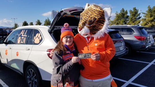 Maggie Shytle with her father, Jason Banks, dressed as Clemson University's mascot, prior to the PlayStation Fiesta Bowl at State Farm Stadium on Dec. 28, 2019.