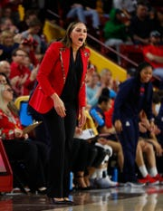Arizona's head coach Adia Barnes yells to her team during the second half against ASU at Desert Financial Arena in Tempe, Ariz. on Dec. 29, 2019.