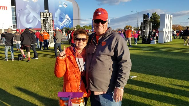 Longtime Clemson Tigers fans Deegie and Benjie McGill, of Clemson, South Carolina, cheer on their team prior to the College Football Playoff semifinal at State Farm Stadium on Dec. 28, 2019.