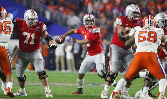 Dec 28, 2019; Glendale, AZ, USA;  Ohio State Buckeyes quarterback Justin Fields (1) throws a 23-year touchdown pass to wide receiver Chris Olave against Clemson in the fourth quarter in the 2019 Fiesta Bowl college football playoff semifinal game at State Farm Stadium. Mandatory Credit: Patrick Breen/Arizona Republic via USA TODAY NETWORK