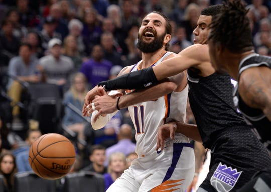 Phoenix Suns guard Ricky Rubio, left, is fouled by Sacramento Kings guard Cory Joseph, second from right, during the second half of an NBA basketball game in Sacramento, Calif., Saturday, Dec. 28, 2019. (AP Photo/Hector Amezcua)