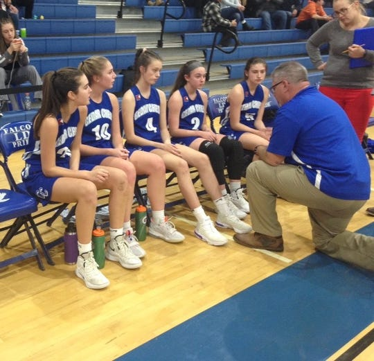 Cedar Crest coach Jim Donmoyer talks with his team, from left, Reese Glover, Sarah Laney, Brooke Shutter, Emily Hocker and Kaya Camasta during Saturday's championship game of the Lower Dauphin Holiday Tournament.