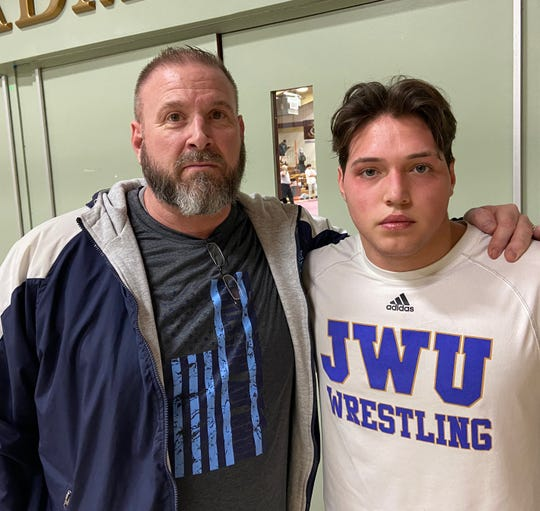 John Jay wrestler Tyler Albis poses with his coach, Jamie Weaver, after competing in the Mid-Hudson Invitational on Saturday.