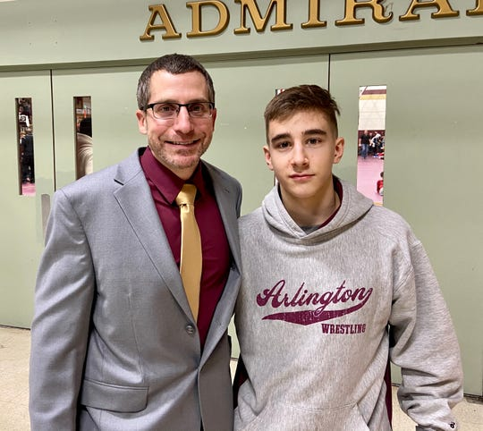 Arlington wrestler Tim Bova poses for a photo with his coach, Dave Grafmuller, after competing in the Mid-Hudson Invitational on Saturday.