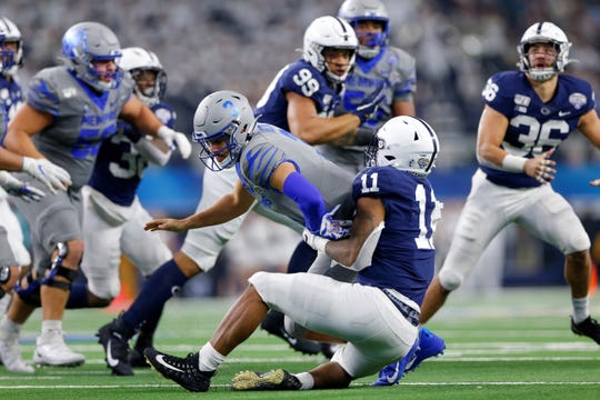 ARLINGTON, TX - DECEMBER 28: Penn State Nittany Lions linebacker Micah Parsons (11) strips the ball from Memphis Tigers quarterback Brady White (3) that results in an interception touchdown return during the Cotton Bowl Classic between the Memphis Tigers and Penn State Nittany Lions on December 28, 2019 at AT&T Stadium in Arlington, TX. (Photo by Andrew Dieb/Icon Sportswire) (Icon Sportswire via AP Images)