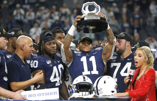 Penn State linebacker Micah Parsons (11) celebrates with his team following the 53-39 win over Memphis in an NCAA Cotton Bowl college football game, Saturday, Dec. 28, 2019, in Arlington, Texas. (AP Photo/Ron Jenkins)