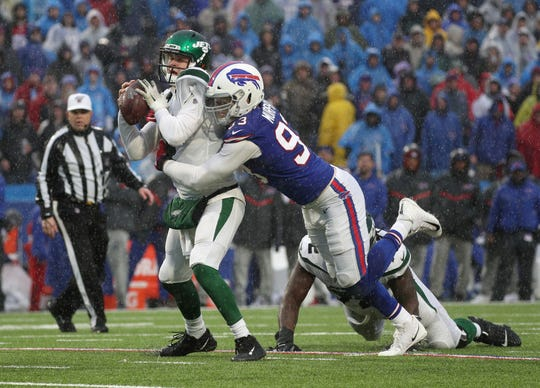 Bills Trent Murphy races in for a sack of Jet quarterback Sam DArnold, near the end of the second quarter.