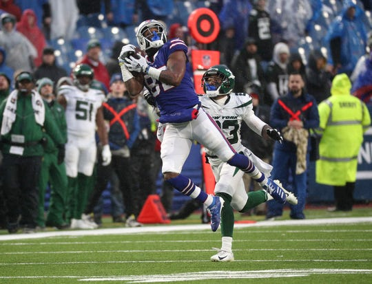 Bills receiver Duke Williams catches a deep pass against Jets defender Arthur Maulet to lead to a Buffalo field goal in a 13-6 loss.
