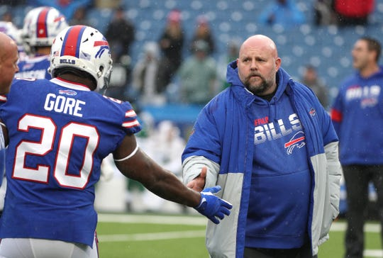Bills offensive coordinator Brian Daboll greets running back Frank Gore before taking on the Jets.