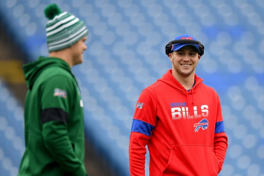 Dec 29, 2019; Orchard Park, New York, USA; Buffalo Bills quarterback Josh Allen (right) smiles as New York Jets quarterback Sam Darnold (left) walks by prior to the game at New Era Field. Mandatory Credit: Rich Barnes-USA TODAY Sports