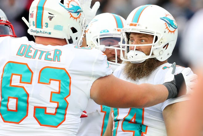 FOXBOROUGH, MASSACHUSETTS - DECEMBER 29: Ryan Fitzpatrick #14 of the Miami Dolphins celebrates with Michael Deiter #63 after scoring a touchdown against the New England Patriots at Gillette Stadium on December 29, 2019 in Foxborough, Massachusetts. (Photo by Maddie Meyer/Getty Images)
