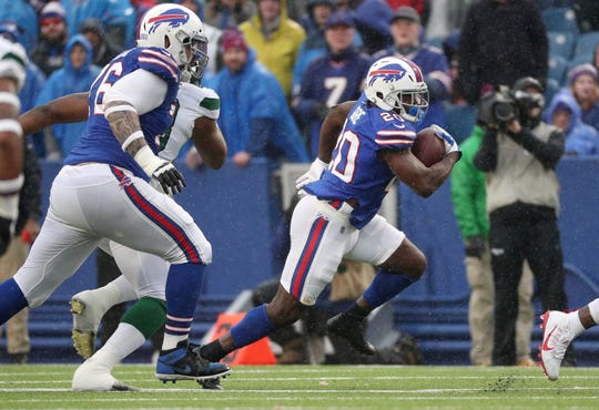 Bills running back Frank Gore looks for room to run against the Jets.