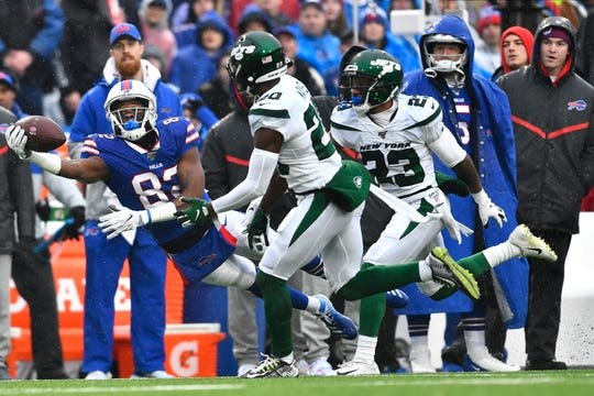 New York Jets' Marcus Maye (20) defends Buffalo Bills wide receiver Duke Williams (82) during the first half of an NFL football game Sunday, Dec. 29, 2019 in Orchard Park, N.Y. (AP Photo/Adrian Kraus)