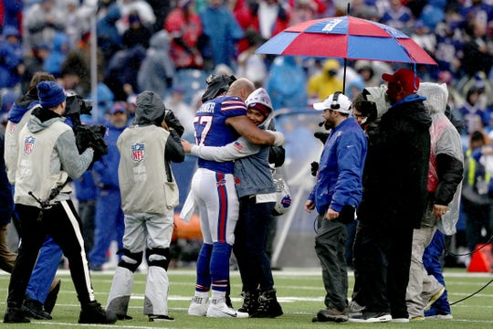 ORCHARD PARK, NEW YORK - DECEMBER 29: Lorenzo Alexander #57 of the Buffalo Bills hugs his daughter Zoie Alexander after she sang the National Anthem before an NFL game between the Buffalo Bills and the New York Jets at New Era Field on December 29, 2019 in Orchard Park, New York. (Photo by Bryan M. Bennett/Getty Images)
