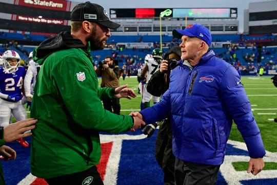 New York Jets head coach Adam Gase, left, shakes hands with Buffalo Bills head coach Sean McDermott after an NFL football game Sunday, Dec. 29, 2019, in Orchard Park, N.Y.
