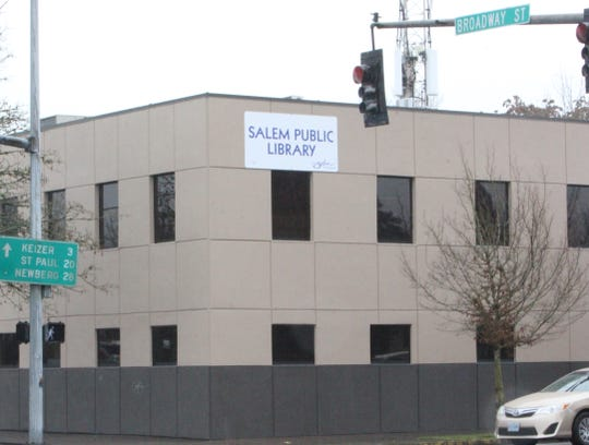 The signs are up at the temporary home of the Salem Public Library on Broadway Street in north Salem.