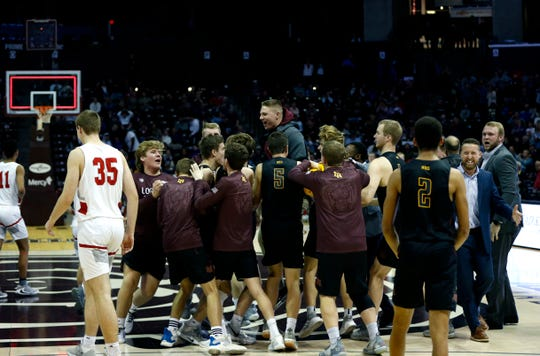 The Logan-Rogersville Wildcats celebrate after a buzzer beater to beat the Nixa Eagles in a semifinal Gold Division game during the Blue and Gold Tournament at JQH Arena on Saturday, Dec. 28, 2019.