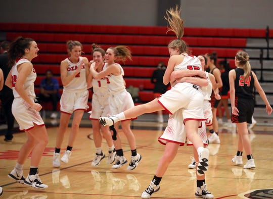The Ozark girls basketball team celebrates after clinching a 48-44 win against Republic on Saturday night at the Pink & White Classic at Drury University.  They will play top-seeded Classen SAS of Oklahoma City in the White Division final at 5:30 p.m. Monday.