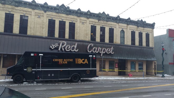 Crime scene tape and a BCA crime investigation van in downtown St. Cloud on Sunday.