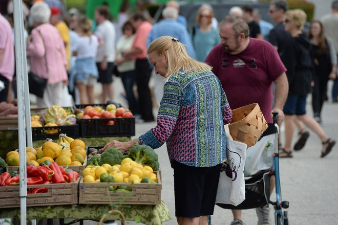 Locals and tourists alike browse and shop among the treasure of food, crafts, flowers, produce, and more, found at the Farmers Market Oceanside on Saturday, Dec. 28, 2019, in Vero Beach. The market, started by the Oceanside Business Association, operates out of Humistion Park along Ocean Drive and is open from 8 a.m. to noon every Saturday year round, rain or shine.