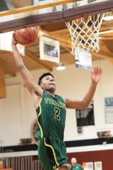 Kingsburg's (2) Colby Charles prepares to dunks against El Diamante in the Polly Wilhelmsen Championship game at the Charles Marshall Court on Saturday Dec 28, 2019.