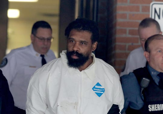 Grafton Thomas, 37, of Greenwood Lake, N.Y. is led into Ramapo Town Court Dec. 29, 2019. Grafton was charged in the stabbings of five Hasidic Jews at a Hanukkah gathering in Monsey, N.Y. late Saturday night.