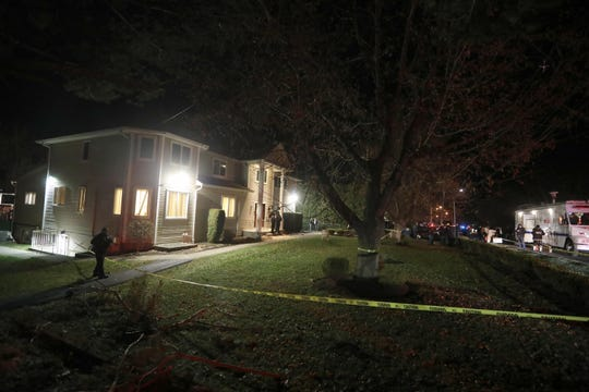 Police stand outside the home of a rabbi on Forshay Rd. in Monsey, N.Y. Sunday night after a man entered the house and stabbed multiple people who were there for a Hanukkah gathering.