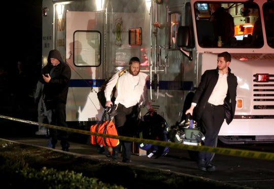 First responders work near the home of a rabbi on Forshay Rd. in Monsey, N.Y. Sunday night after a man entered the house and stabbed multiple people who were there for a Hanukkah gathering.