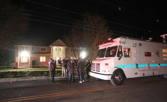 Police work at the home of a rabbi on Forshay Road in Monsey, N.Y. Saturday night after a man entered the house and stabbed multiple people who were there for a Hanukkah gathering.