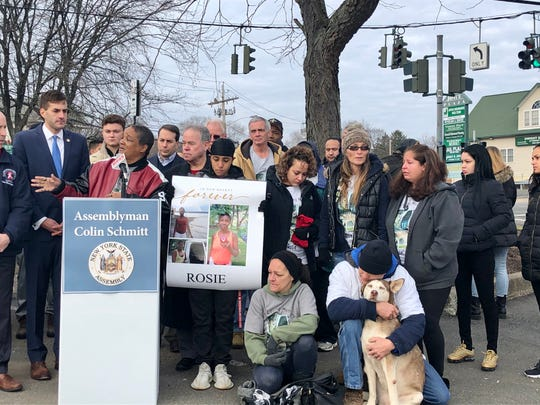 Friends, family and county officials gather at a rally honoring Maria Rose Osai, who was killed in a hit-and-run Christmas Eve.