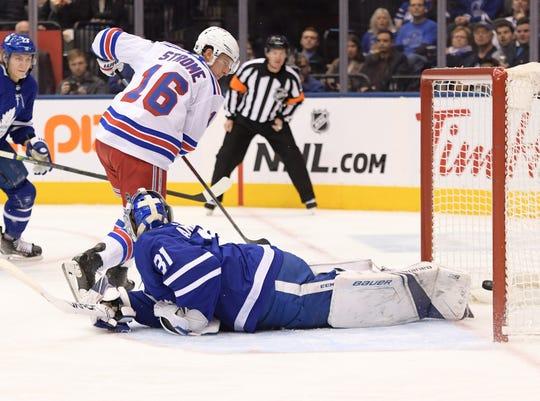 Dec 28, 2019; Toronto, Ontario, CAN;   New York Rangers forward Ryan Strome (16) scores past Toronto Maple Leafs goalie Frederik Andersen in the first period at Scotiabank Arena. Mandatory Credit: Dan Hamilton-USA TODAY Sports