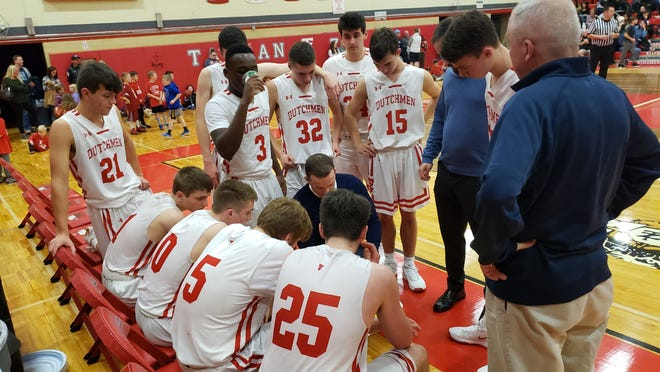 Tappan Zee gathers during a time out, in the Dutchmen's 69-60 victory over Poughkeepsie.