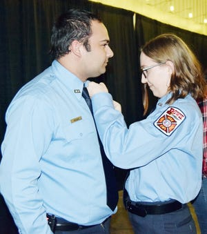 During the recent firefighter badge pinning ceremony, Abe and Sydney Rizwan, gave each other their new shields representing the Bowie Fire Department. The two mark the first time a married coup;e has served the city as volunteers.
