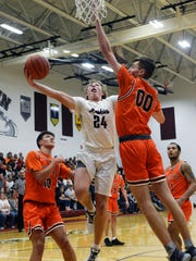 Reece Perkins goes up for a shot in the lane while Addy Black tries to block it during John Glenn's 42-32 loss to visiting Meadowbrook on Saturday in New Concord. Perkins had a team-high 13 points.