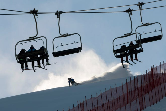 In this file photo from Nov 23, 2018, racers free ski on the giant slalom course before the women's 2018 Audi FIS Alpine Skiing World Cup races at the Killington Resort in Vermont.