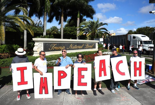Protesters at the Trump National Doral golf resort on Dec. 17, 2019 in Doral, Florida.
