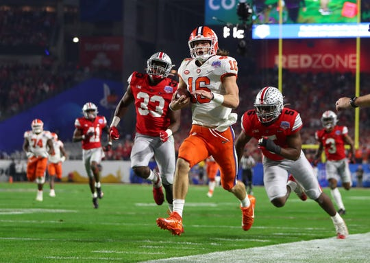 Clemson quarterback Trevor Lawrence breaks free to score a touchdown against Ohio State during the first half in the 2019 Fiesta Bowl.