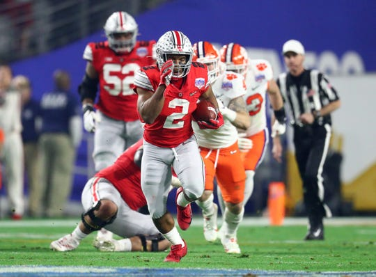 Ohio State's JK Dobbins is projected to be selected after the first round in the NFL Draft.