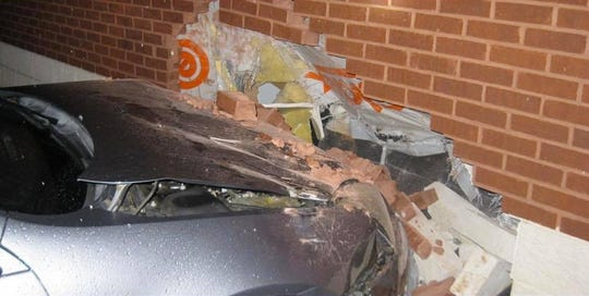 An Alexandria woman was arrested early Sunday after she drove into a wall at Louisiana State Police Troop E headquarters.