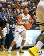 Monmouth's Deion Hammond prepares to launch a 3-point shot during Monmouth's win over Albany on Dec. 21 in West Long Branch.