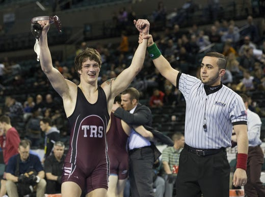 Toms River South's Cole Corrigan gets his hand raised after he won the 2018 NJSIAA 152-pound championship