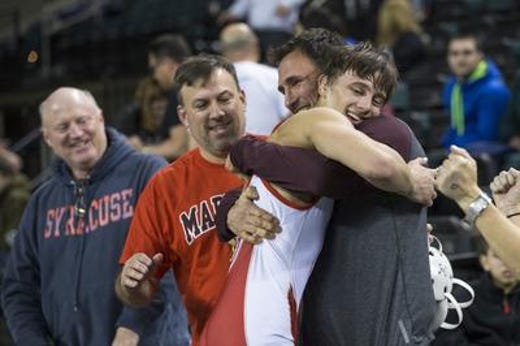 Ocean's Jake Benner is hugged by family and friends after he won the 2017 NJSIAA 138-pound championship