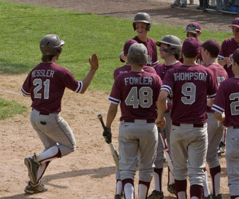 Former Toms River South outfielder Russell Messler (No. 21), shown being congratulated after hitting a home run in May, 2013, had consecutive seasons where he hit over .500 in 2012 and 2013.