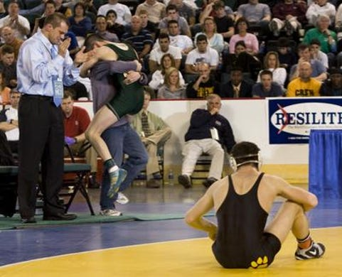Mike Morales jumps into the arms of then Brick Memorial assistant coach Tony Nash after winning the 2009 NJSIAA 130-pound championship. Former Brick Memorial head coach Dan O'Cone (left) applauds