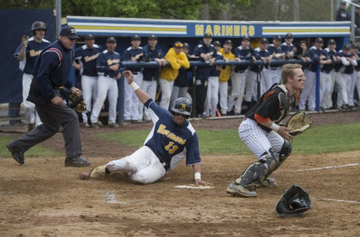 Joey Rose, shown sliding home with a run in a 2016 Ocean County Tournament quarterfinal against Barnegat and standout Barnegat pitcher Jason Groome, is currently in the Arizona Diamondbacks' organization.