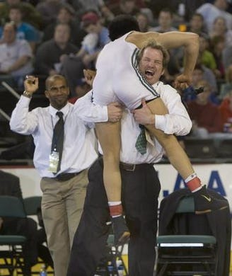 Scott Festejo jumps into Long Branch coach Dan George's arms after he won the 2010 NJSIAA 135-pound championship
