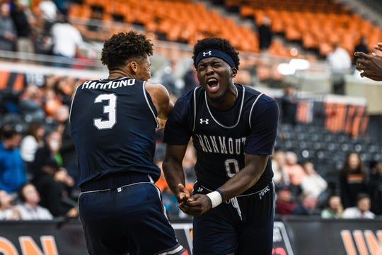 Monmouth's Ray Salnave (3) and Deion Hammond (3) celebrate after Salnave's game-winning 3-point at the buzzer beat Princeton at Jadwin Gym on Dec. 10.