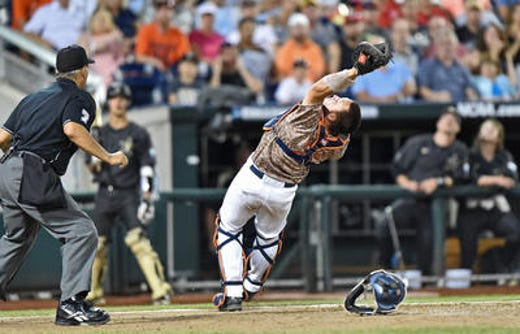 Former Jackson Memorial star catcher Matt Thaiss, shown catching for the University of Virginia during the 2015 NCAA College World Series, is currently a first baseman with the Los Angeles Angels.