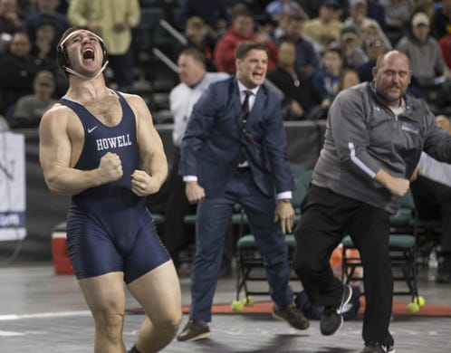 Howell's Eric Keosseian celebrates after winning the 2017 NJSIAA 220-pound championship. Howell assistant coaches Rich Gildner (right) and Peter Reilly (left( celebrate behind Keosseian.